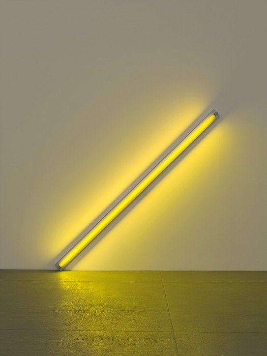 Fluorescent yellow light installed at a 45-degree angle to the right and with the left corner touching floor.