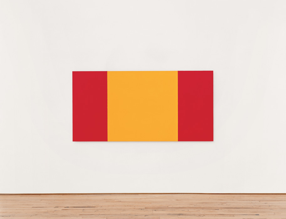 Rectangle with three vertical bands of color, two red on the outside and one wider yellow band in the center, hung on a white wall.