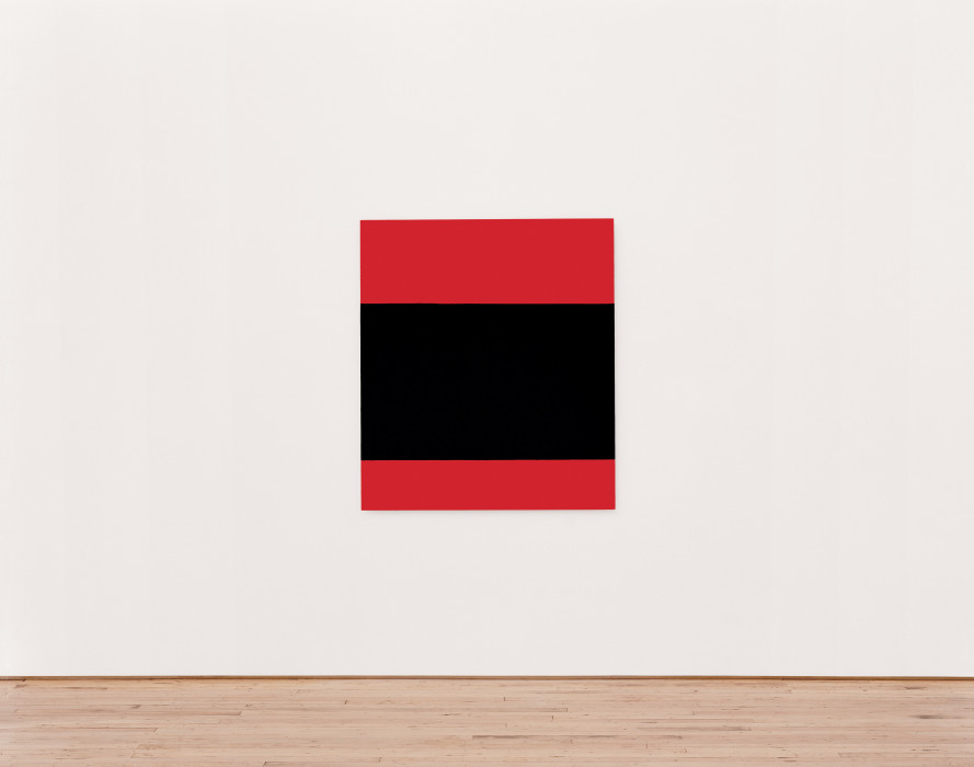 A rectangular canvas with three horizontal bands of colorÑred on the top and bottom and a wider black band in the centerÑhangs on a white wall.