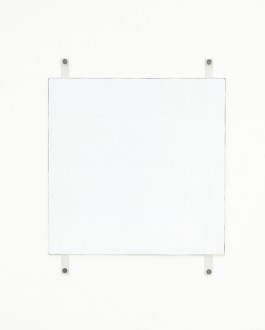 A white square with dark edges hangs on a white wall using four exposed fasteners with bolts, two on the top and two on the bottom.