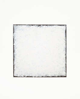 A square black board is painted nearly to the edges with small, rough strokes of white paint.
