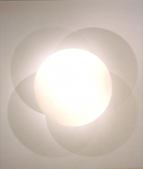 A central, circular, bright shape casts four intersecting shadows on a nondescript background.
