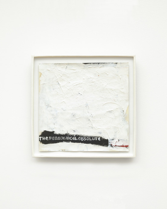 A square canvas coated in thick, textured white paint features a small black bar with the phrase